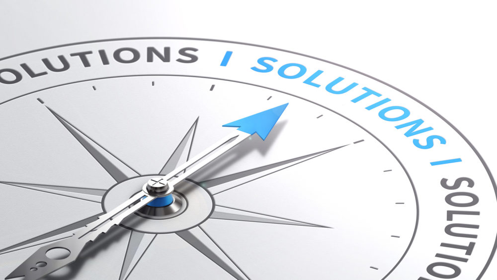 Graphic of compass pointing to solutions text