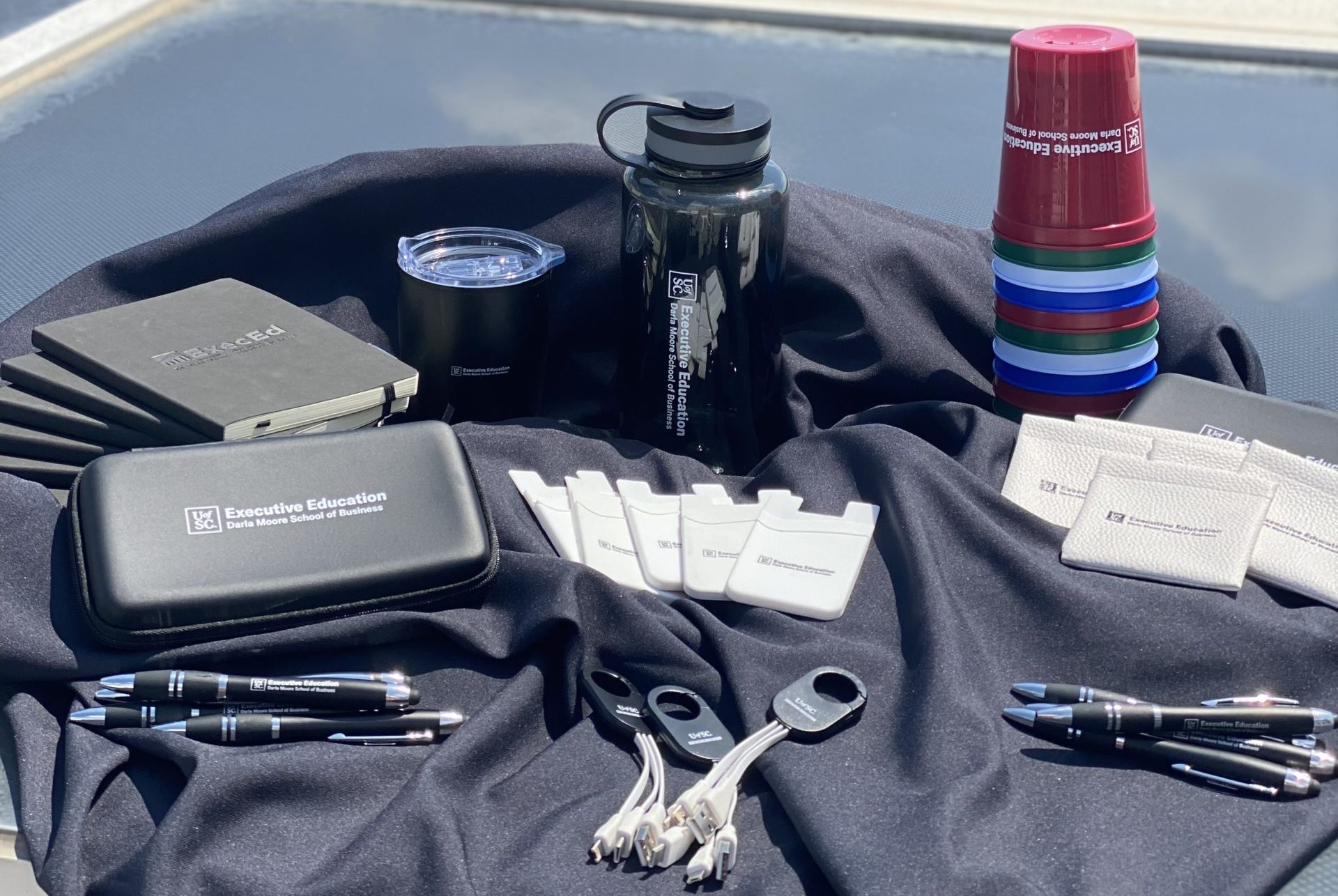 ExecEd promo items displayed on table